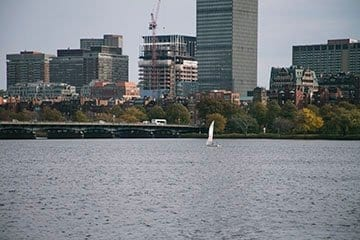 sailboat-in-charles-river-with-buildings-5inch.jpg